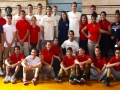SC Men's Volleyball Team with Commerce High School Students